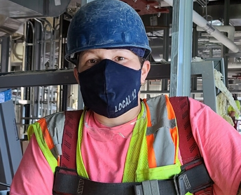 Local 12 Boston Plumbers member with mask